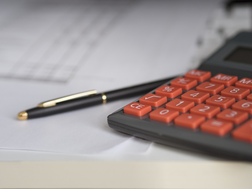 pen and calculator used to determine monetary loss
