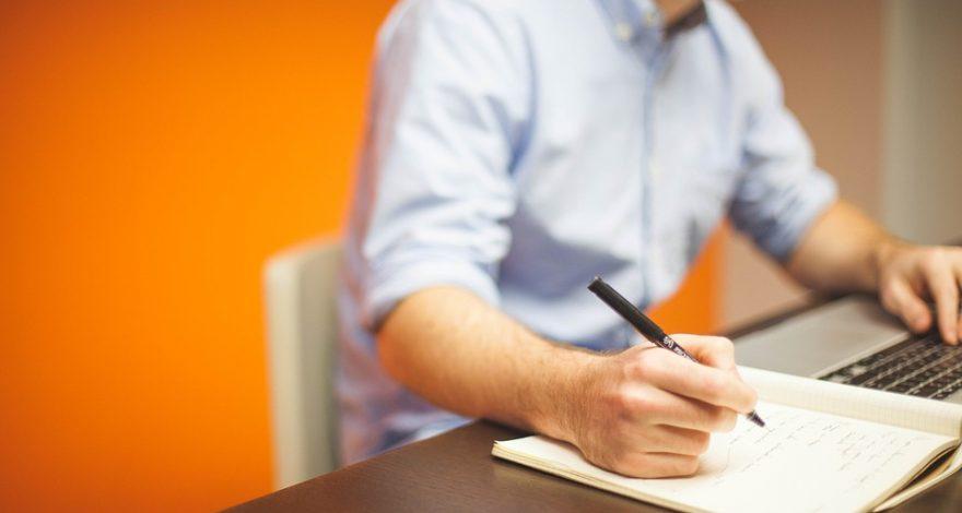 man drafting a business plan