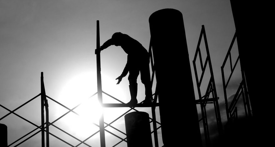 immigrant man working construction - workers comp