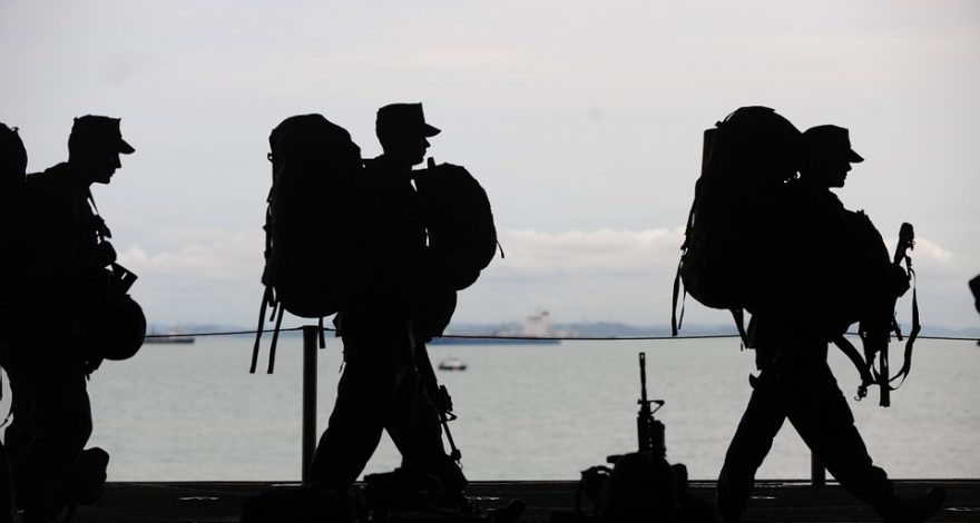 military men in silhouette - international service of process