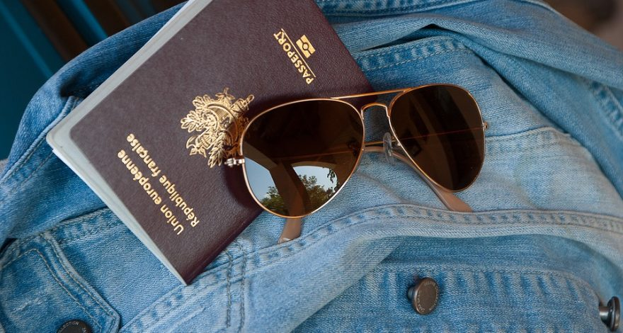 passport on top of a denim jacket - passport translation