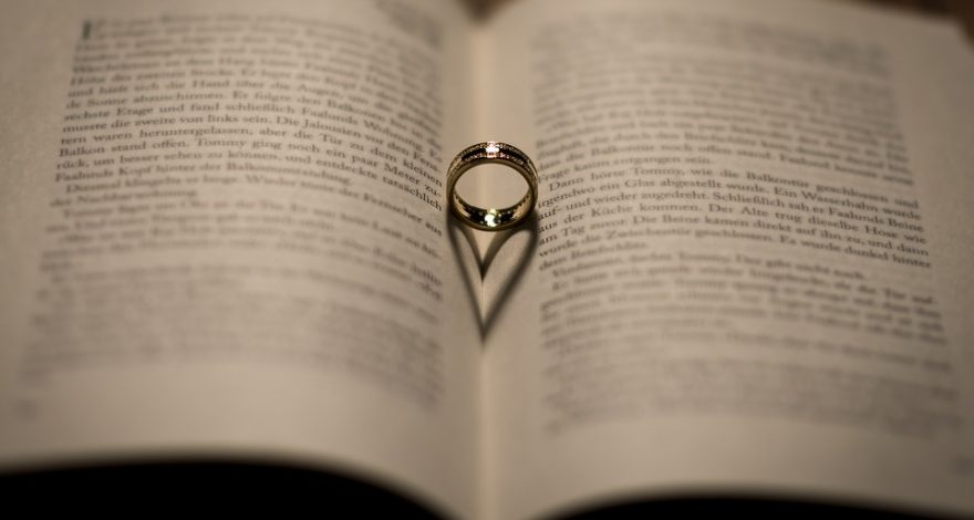 wedding band atop law book