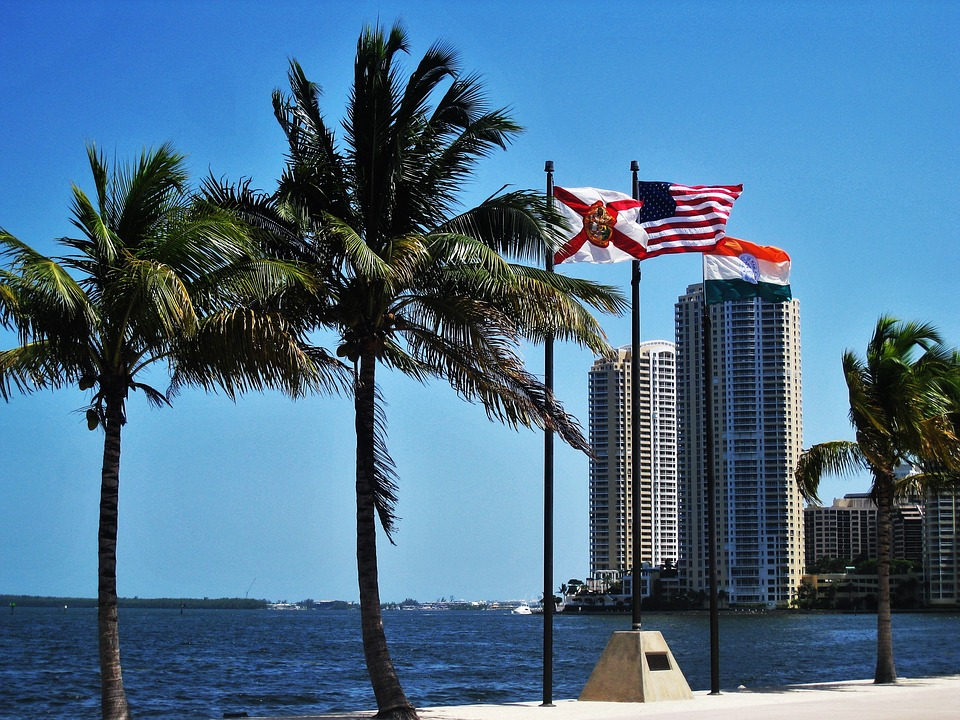 Miami skyline with Florida state flag - court interpreting guidelines