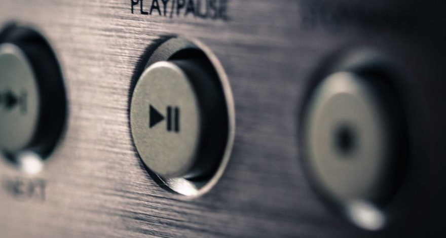 close up of audio player play/pause button