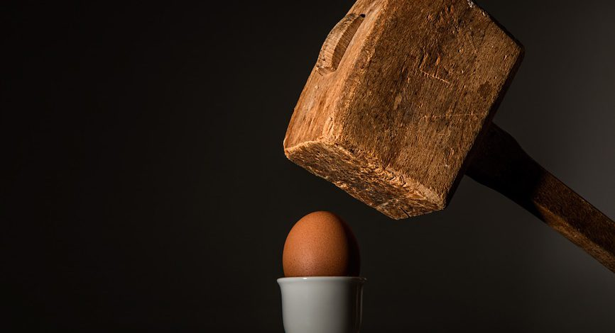 hammer and egg representing quashed service of process