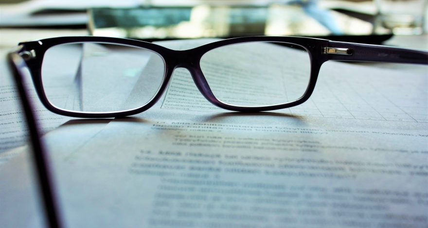 waiver of service: documents requesting a waiver of service with glasses on top